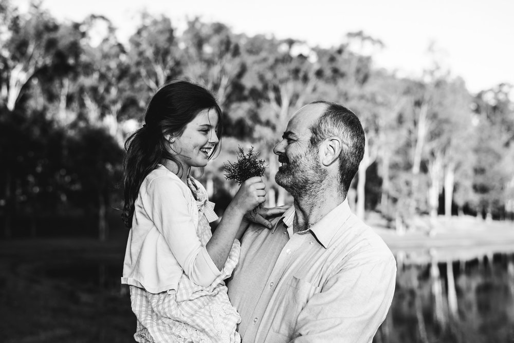 portrait of dad and daughter outdoors
