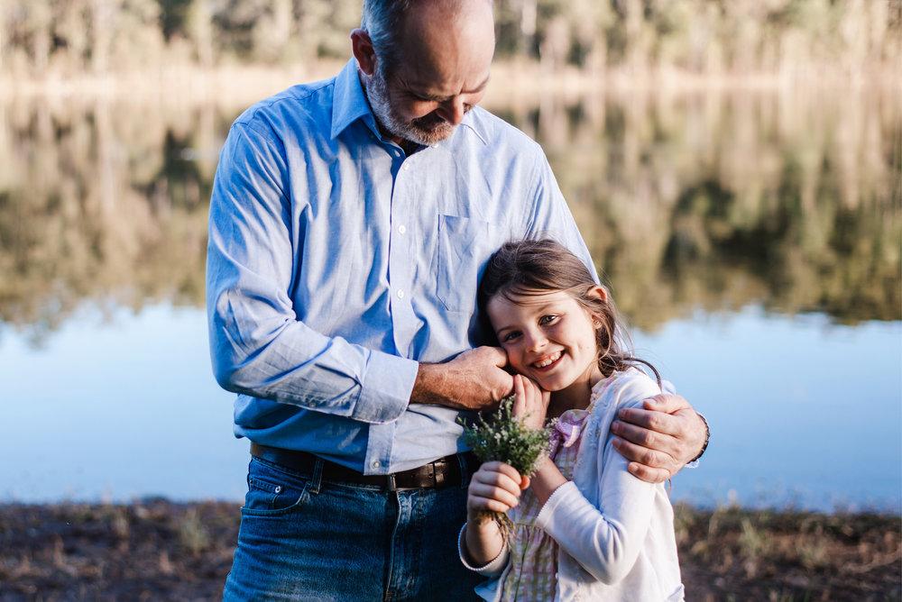 dad and daughter near lake