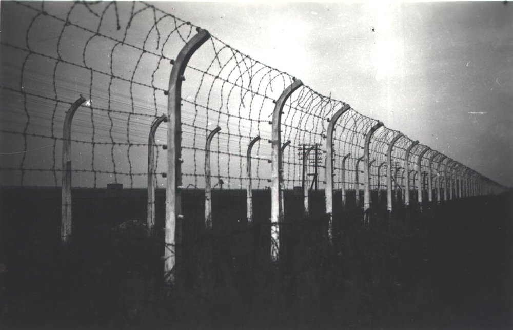 Going to the fence - desperate prisoners were known to commit suicide on the electric fences surrounding Fünfteichen camp. [Gross Rosen Museum]
