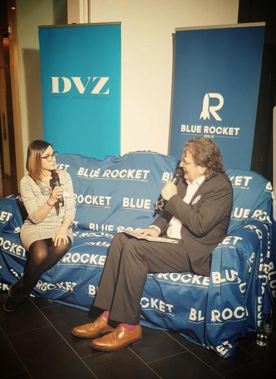 Amanda Del Valle Diaz describing Clinch Logistics in the blue couch of the DVZ.