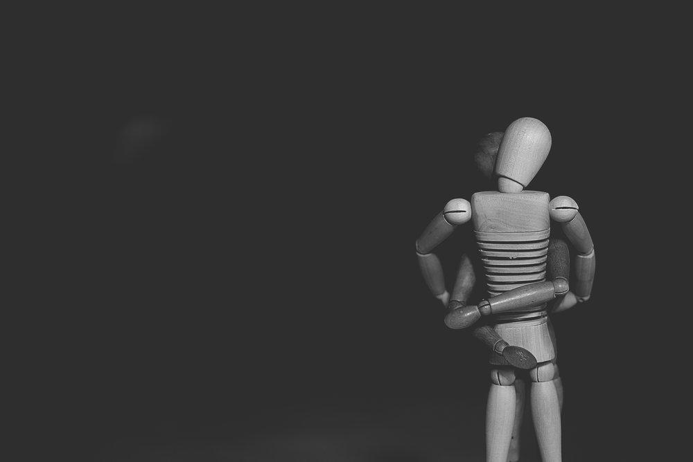 Wooden figures getting it on.jpg