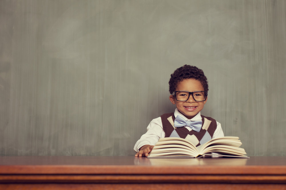 http://www.istockphoto.com/gb/photo/young-boy-nerd-reading-at-desk-in-classroom-gm482132881-37386450