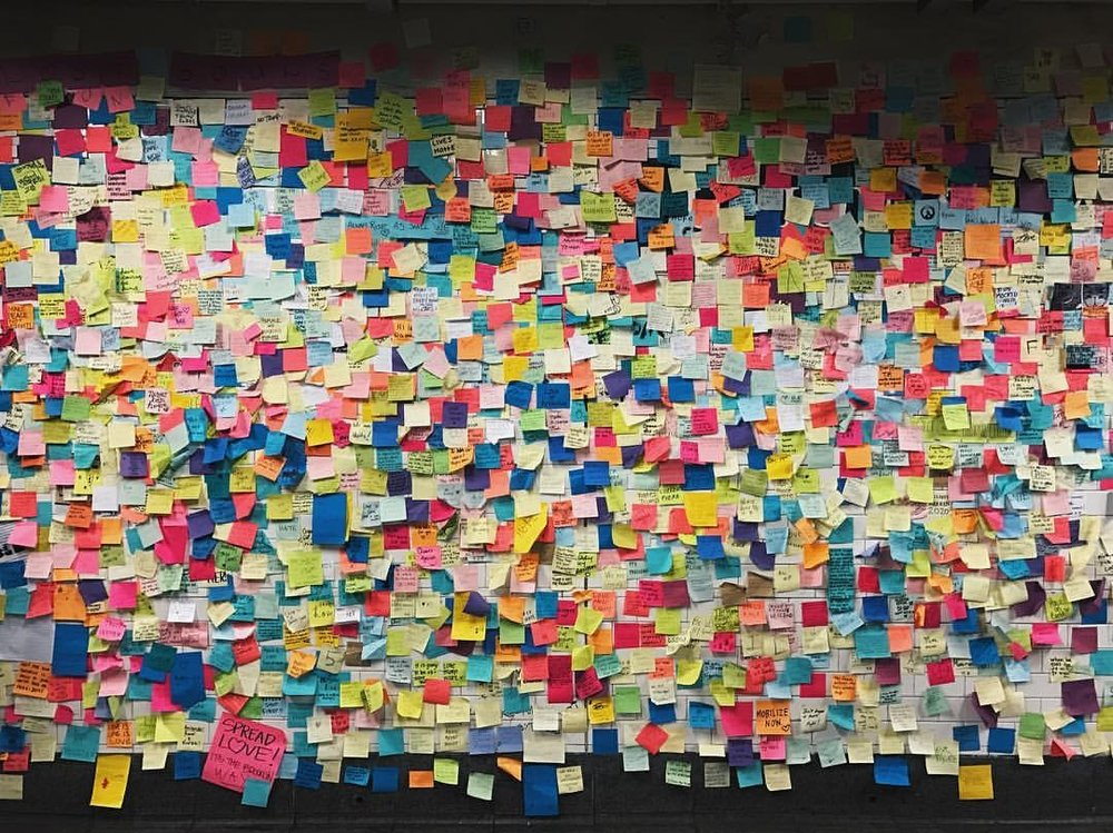 "Post-it notes from around the world. The pink one on the bottom left reads ""Spread love! It's the Brooklyn way""    #spreadlove #postitnotes #subwaytherapy    (at 14th Street-Union Square Station)"