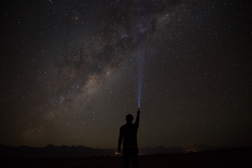 \ I FOUND THE MILKY WAY \    I think these images will be a defining moment in my career, not just because of the images themselves but for the process, determination, tenacity, hard work, patience, courage, and luck it took to make them a reality and bring them to life.     I specifically came to the Atacama Desert with the sole purpose of seeing the Milky Way and capturing these images. Foolishly, I did not research the phases of the moon and arrived at the worst time. It was a hard lesson to learn but an important one. So I was a bit sad after I arrived and felt defeated. I decided to wait around for the new moon, passing the time here with yoga, reading, and mountain biking with friends.     The past 4 nights I've woken up (or in some cases didn't sleep at all) at 3 am, and rode a bike, in true expedition fashion, several kilometers out into the desert alone to capture this image and many others like it. It's a bit scary riding out into the pitch black desert alone, but it's absolutely worth it. I learned some constellations and used the southern cross to guide me. I was lucky because the past 4 night have been totally clear, unlike last week. I can't begin to describe the feeling of lying down beneath the clear, dark, moonless sky of the Atacama Desert with not a single soul or light in sight other than the Milky Way and the stars above me. It is totally peaceful, serene, magical, beyond beautiful, humbling, and absolutely mind blowing/breathtaking. I've never felt such a strong feeling of fulfillment and joy seeing the Milky Way bulge rise, and taking in all of the stars surrounding me. Not to mention, the shooting stars (meteors) are so numerous out here and are like none I have ever seen before. We truly live in an extraordinary galaxy and all the stars seem to align perfectly.     I must thank astrophotographers @nicholasbuer and Dr. José Francisco Salgado for guiding me from halfway across the world. These images would not have been possible without their help and guidance.    I hope this image inspires you in one way or another.    All My Best,  Reuben    #antarcticaordie #milkywaygalaxy     (at Atacama Desert, Northern Chile)