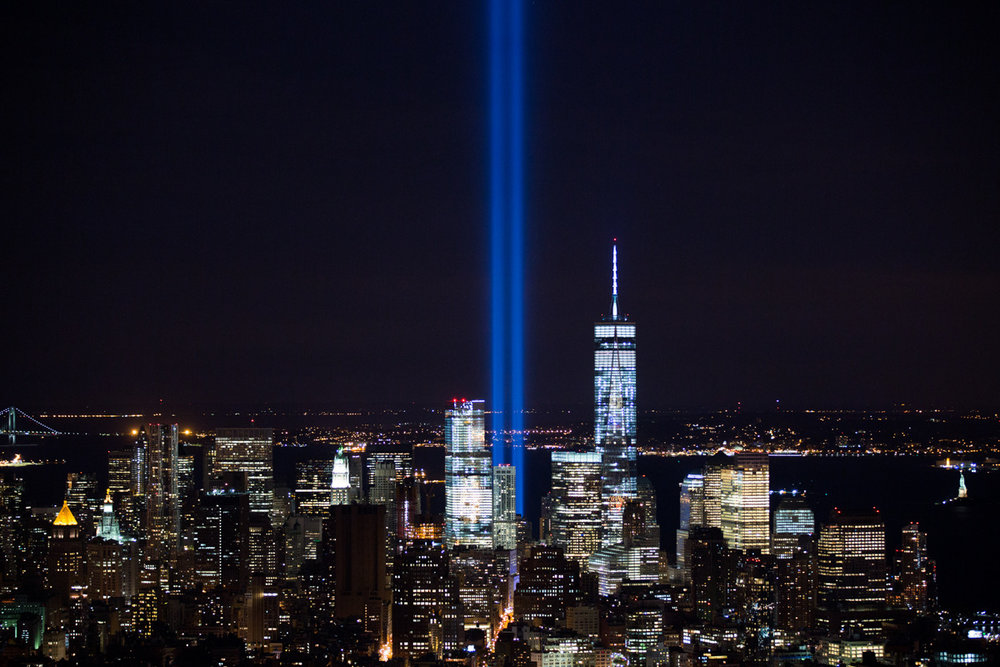 September 11, 2014   For this photo I had to rest my camera on top of an external hard drive because my tripod got taken away. Photographing the Tribute In Light has become somewhat of a ritual for me. It's a lot of work and many hours spent just to get a single image, but I never ever stop to think twice about it.   Copyright Reuben Hernandez. All rights reserved.