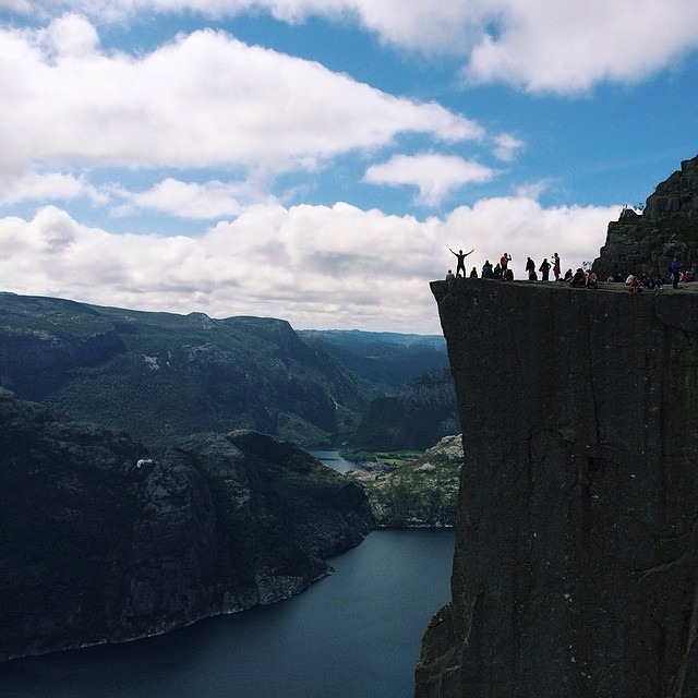 Monday in Norway - I made it to the top of Preikestolen! Preikestolen is a steep and massive cliff 604 meters above Lysefjorden. The top of the cliff is flat (25 by 25 meters) and formed about 10,000 years ago during the ice age.   Norway is one of the most beautiful, picturesque countries I have ever visited, and Preikestolen is by far one of my all time favorite travel experiences. Enjoying the breathtaking view of Lysefjorden with my feet dangling off the edge of that cliff was transcendent. #preikestolen #lysefjorden #fjord #stavanger #norway #vscocam #vsco #thisarcticlife  (at Preikestolen - Pulpit Rock, Norway)