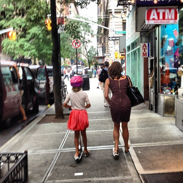 Mom and daughter cruising NYC on Razor scooters. Seeing this reminds me why I love this place so much. (Taken with  Instagram  at Union Square (14 Street))