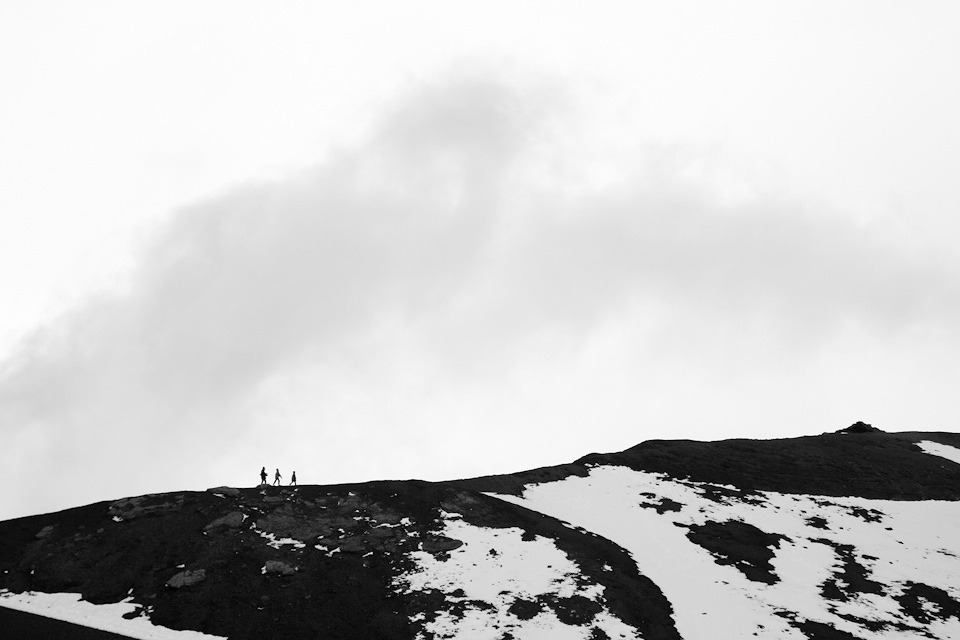 Image copyright Reuben Hernandez. All rights reserved.   This is one of my favorite photos, composition wise, that I took last year. 3 people climbing Mt. Etna in Sicily, Italy. We almost didn't make the drive to the base due to the snow covered roads but I'm sure glad we did.