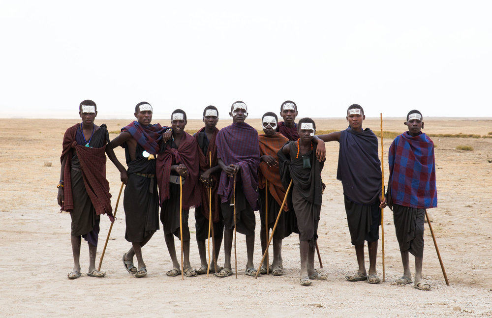 One rite of passage from boyhood to the status of junior warrior is a painful circumcision ceremony, which is performed without anaesthetic. These young Masaai warriors have been recently circumcised.     #bigcatsplayball    (at Serengeti National Park, Tanzania)