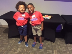 "The boys with their new camp t-shirts on after checking in at my church's ""Out of this World"" summer camp!"