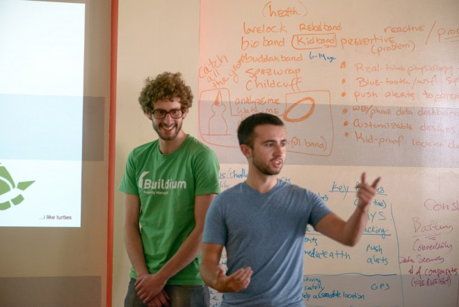 Pat (right) presents deliverables at the IdeaHack