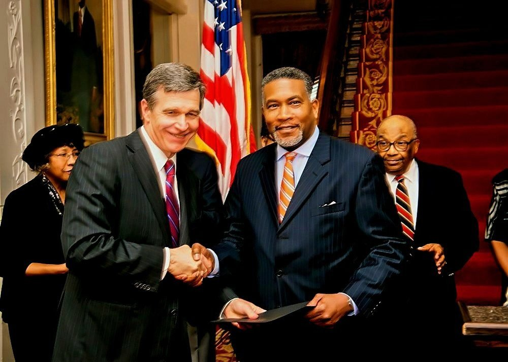 Receiving the Old North State Award from Governor Roy Cooper