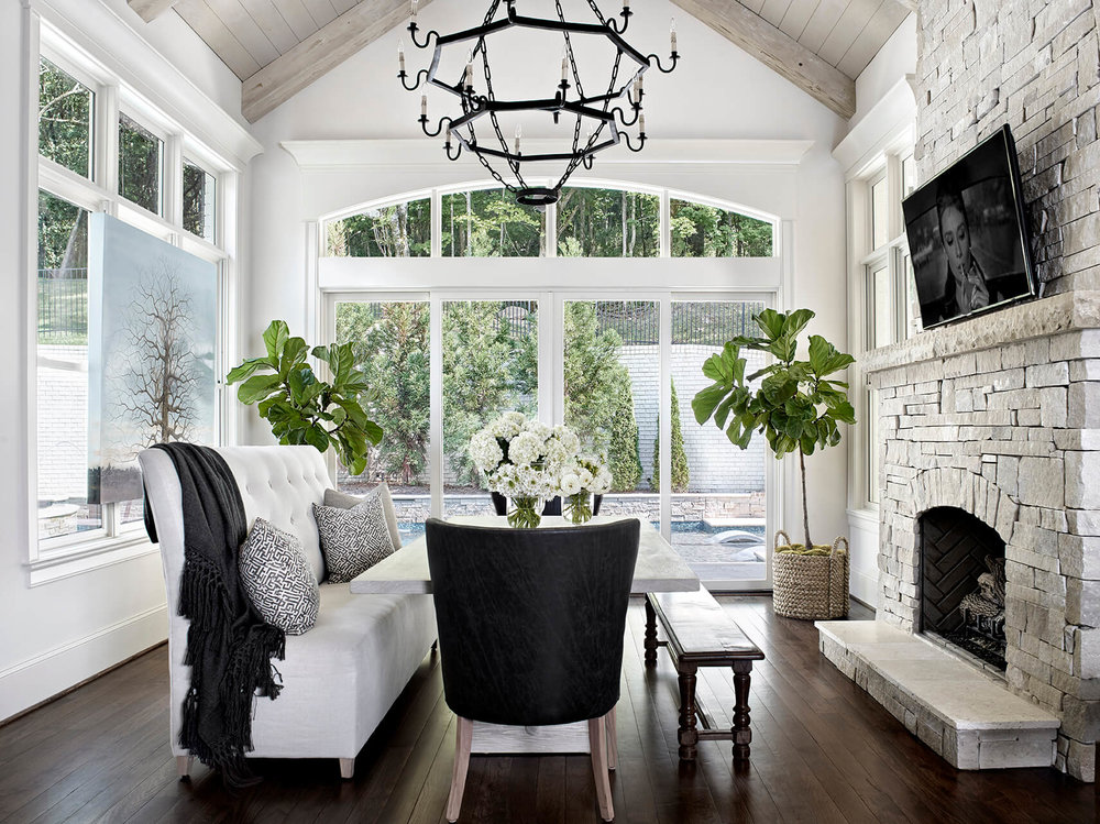 Bon Dining Area With Stone Fireplace And White And Black Furniture   Rustic  Contemporary Bureau Interior Design