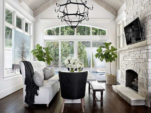 Dining Area With Stone Fireplace And White Black Furniture