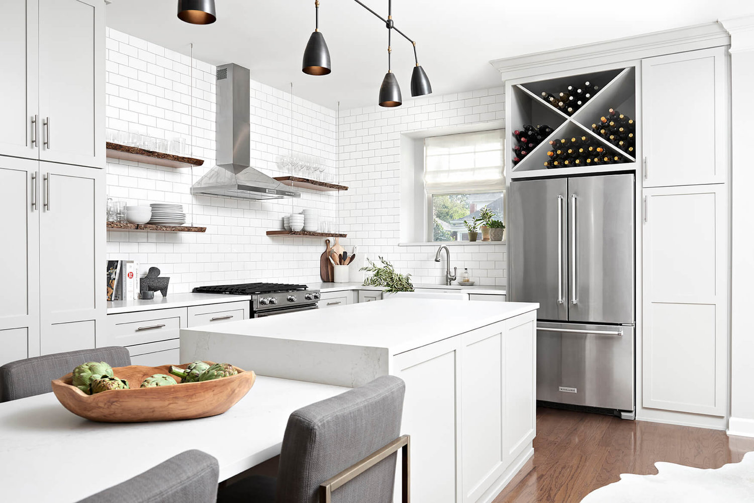 white brick kitchen with gray cabinets stainless steel appliances white counters wood accessories - Bureau Design