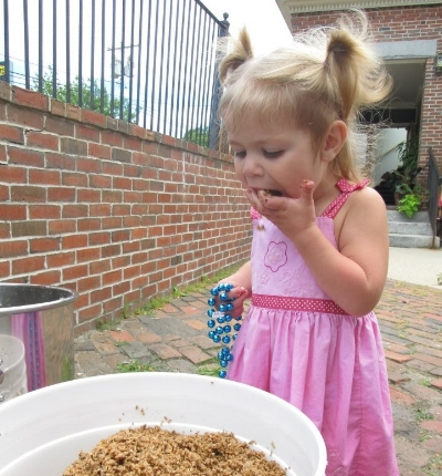 Our daughter Meadow munching on some spent grain after a brewing demonstration at Yeastern Homebrew Supply.