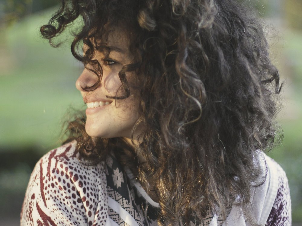 a-young-woman-smiling-as-the-rain-pours-down_t20_wa99jK.comp.jpg