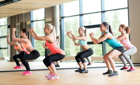 30613553_S_fitness_exercise_squats_woman_sneakers_workout_aerobics_athete.jpg