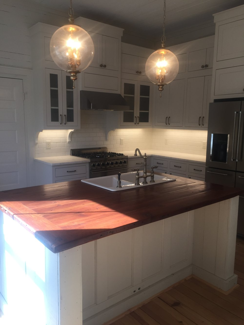 Shealy Kitchen pantry door closed island angle all AFTER.JPG