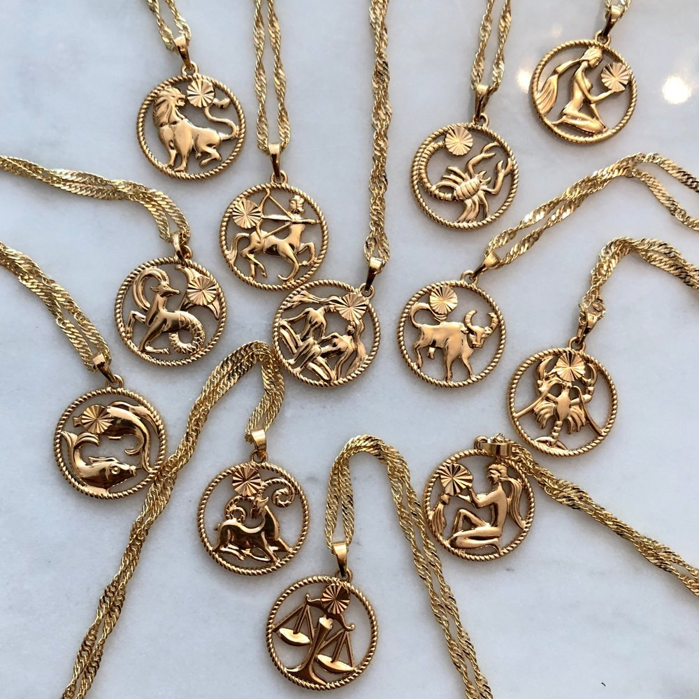 What's Your Sign? - Shop this summers best selling necklace and get your stack fall ready with our zodiac necklaces. I mean who doesn't love astrology.