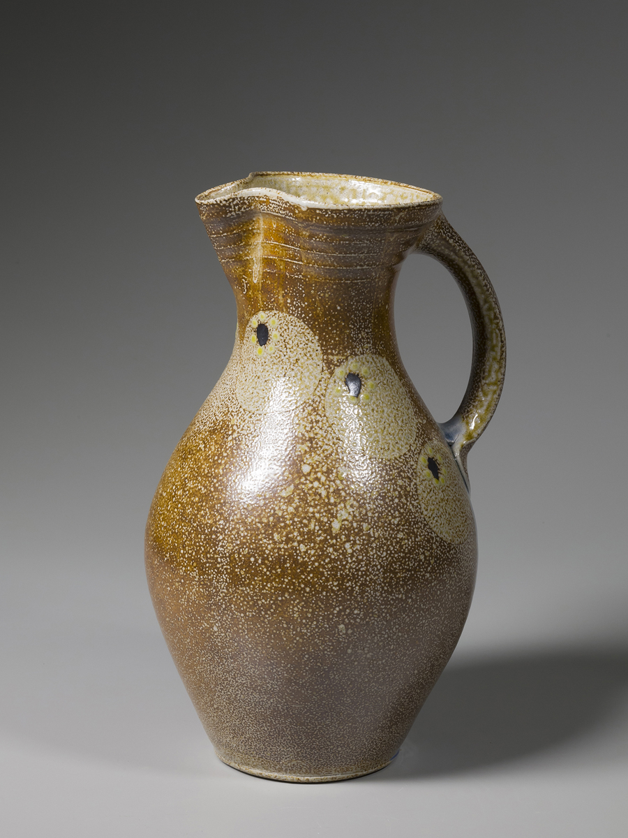 "Mark Hewitt  Pitcher, kaolin slip with salt glazed circles, black and yellow dots, and blue glass run on handle,   Stoneware 14.5 x 9 x 9"" MH232"