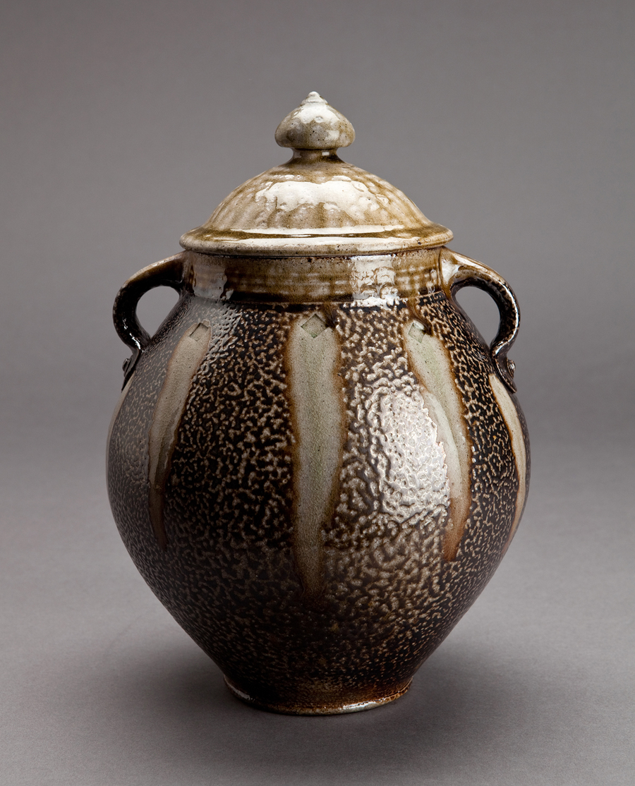 "Mark Hewitt  Half-gallon lidded jar with handles, ash glaze and black slip with pale glass runs  Stoneware 12 x 8 x 8"" MH23"
