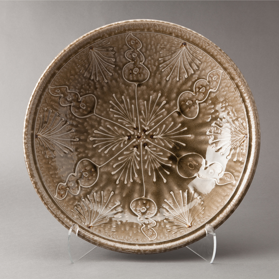 "Mark Hewitt  Platter, alkaline glaze with white slip floral decoration  Stoneware 4.5 x 19.25 x 19.25"" MH95"