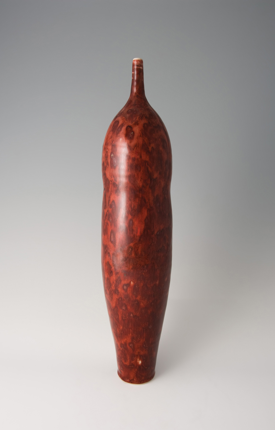 "Brother Thomas Bezanson  Tall Narrow Vase, Textured Copper Red Glaze  Porcelain 20.25 x 4.5 x 4.5"" TH815B"