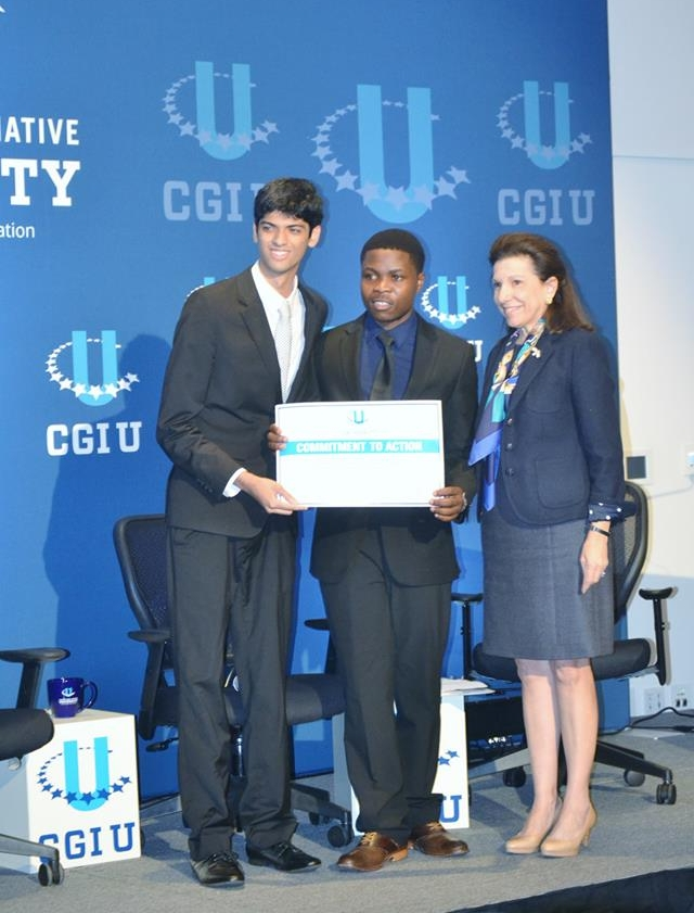 Tamjid and Ngoni receive a Commitment to Action certificate for SGP during a Working Session at CGI U in Miami, 2015. Picture: Tamjid Munir/SWS