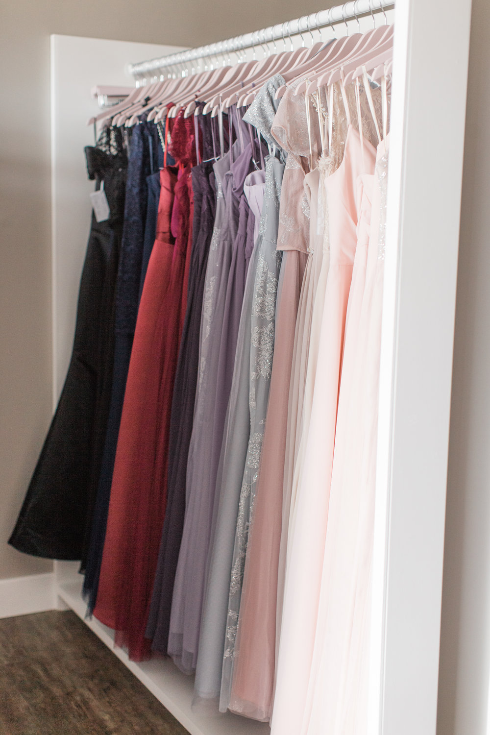 - Your friends will love our bridesmaid shopping experience! Our team is organized and ready to help you select a bridesmaid dress that perfectly fits your vision. Our collections range in price from $200-$450 (Almost all are under $300.)Are you a Rhylan Lang bride? We have a little something for your girls if you also select your bridesmaids with us. Don't forget to let us know if you bought your dress with us too!