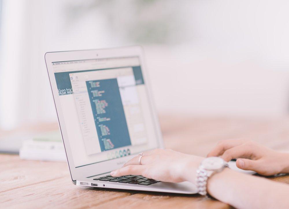 woman coding on laptop.jpg