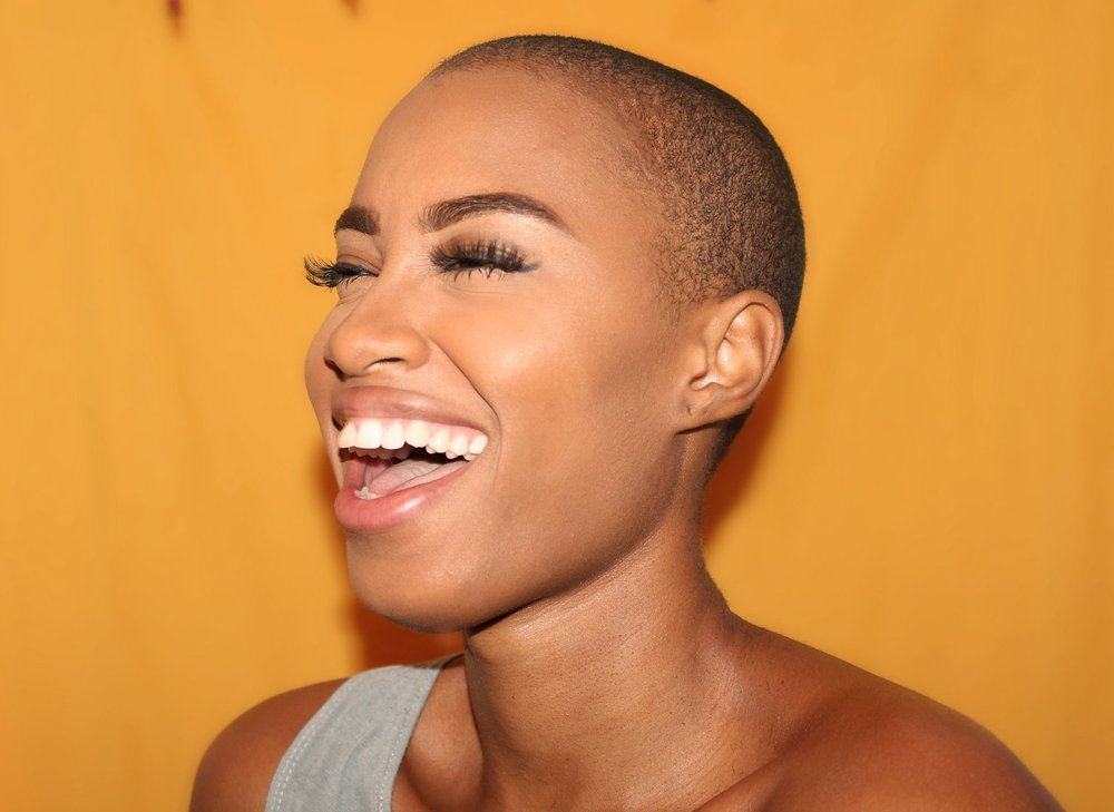 woman laughing with eyes closed.jpg