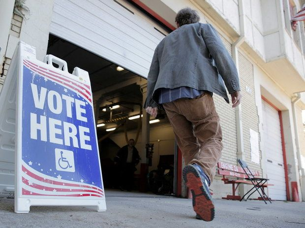 A voter heads into Engine 26 Ladder 9 fire station on South Jeff Davis Parkway as New Orleans residents cast their ballots in the Dec. 10 runoff election.((c) Dinah Rogers)