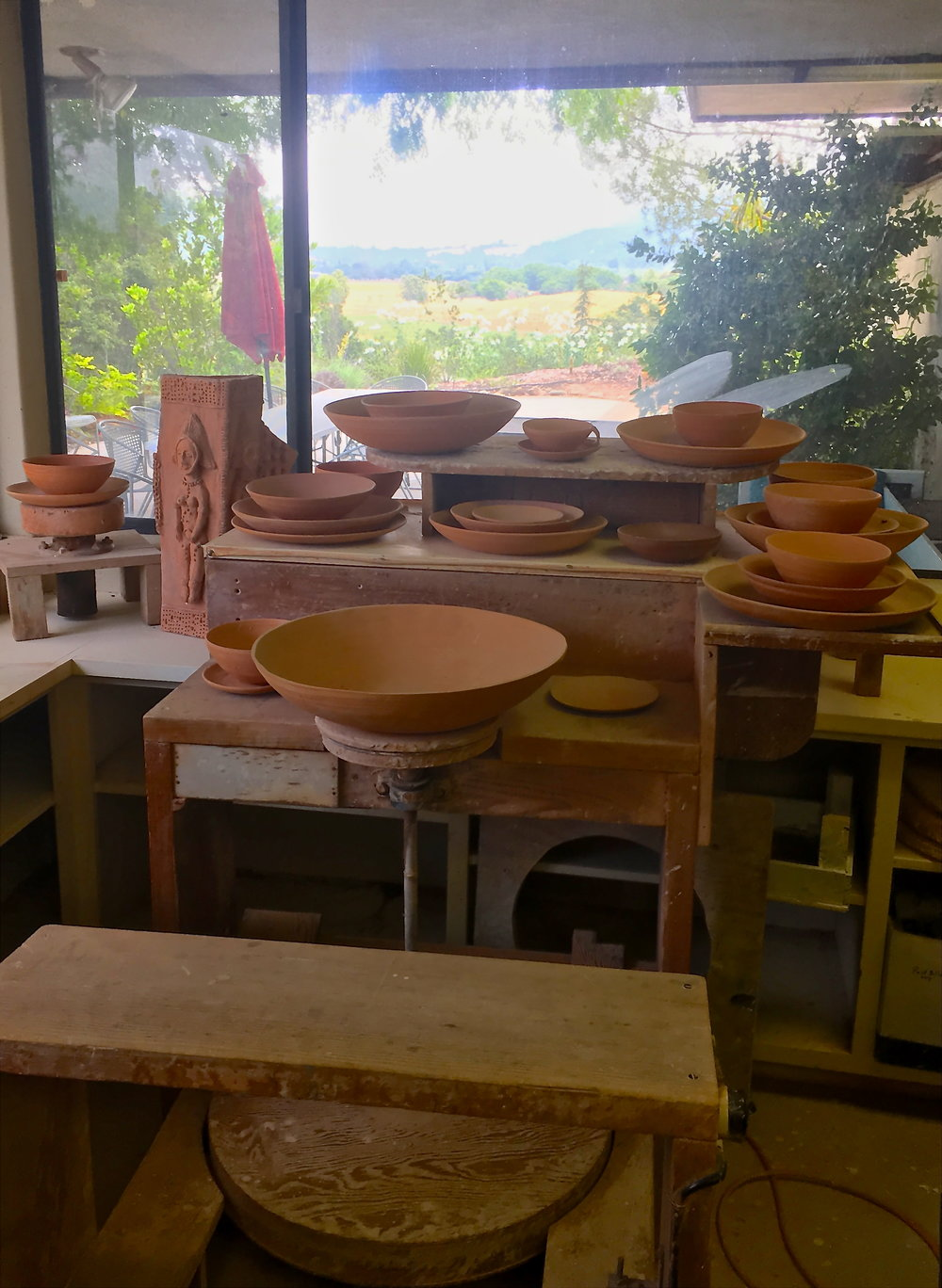 Beatrice Wood's wheel overlooking Happy Valley remains idle with her last pots surrounding it, which remains an inspiration to all who visit or get the privilege to work in her studio.  -
