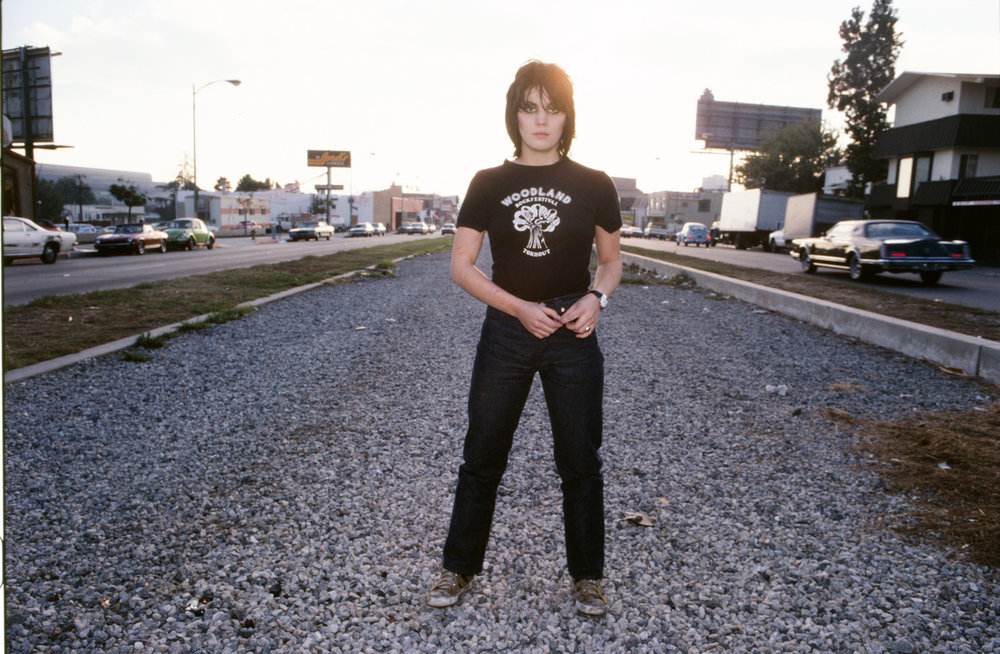 Joan Jett: Joan Stops Traffic, 1977 - I saw the sun setting to the west as Joan and I were on Santa Monica Blvd and I asked Joan to stand in the middle of the street. Joan NEVER required any direction.  As the sunset, I took this Kodachrome photo. Today this spot looks totally different. You wouldn't recognize it today, but if you like, you can go stand there. It is directly across from 8585 Santa Monica Blvd, where the old Tropicana Motel once stood. Be careful crossing the street!!
