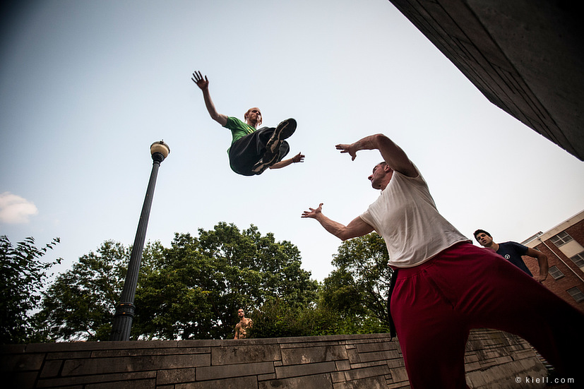 Kurt completing a running cat leap, with Benoit below ready to spot. At American Rendezvous, 2012, in Columbus, Ohio. Photo by  Andy Day .