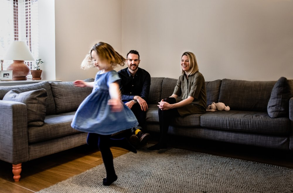 Girl spinning in home family lifestyle shoot in Peterborough