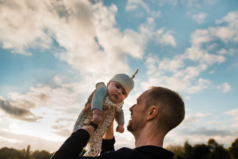 Baby in the sunset sky - happy family moments captured by Diana Hagues