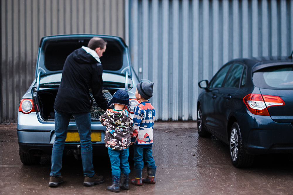 Loading up the Christmas tree into the car - Cambridge family documentary and storytelling photoshoot