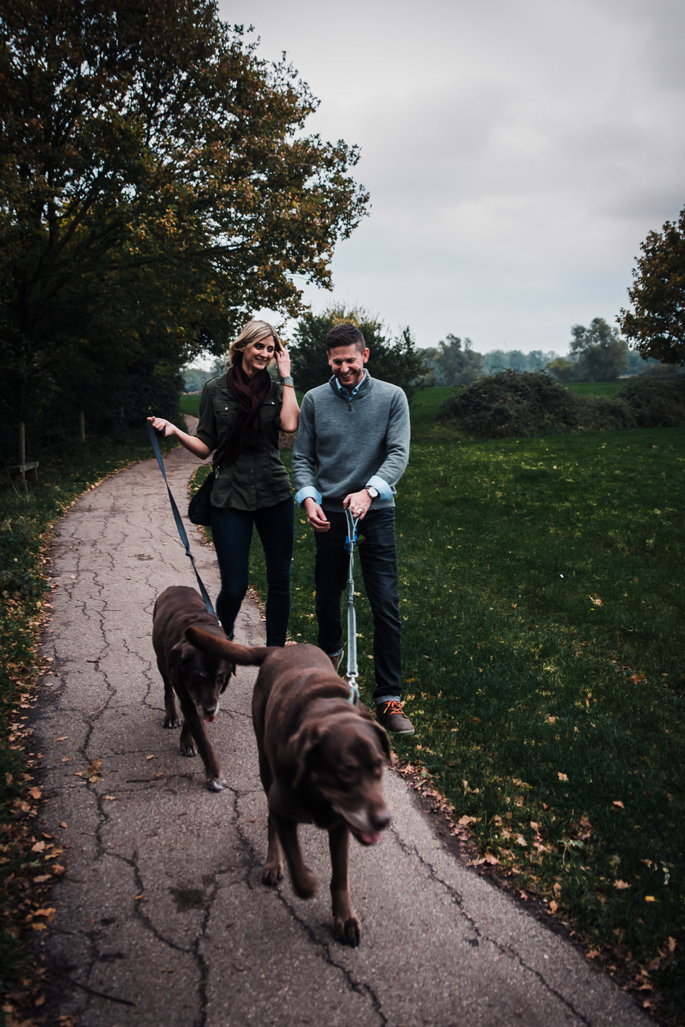 Natural and relaxed portrait of a couple on a dog walk