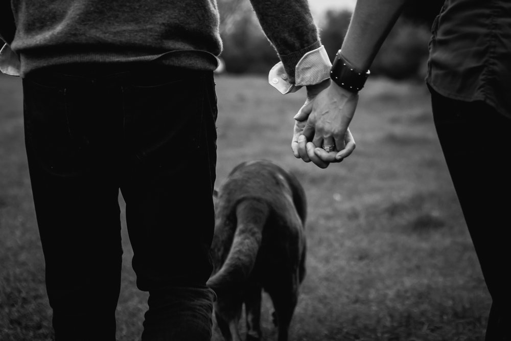 Holding hands during a couples shoot in black and white