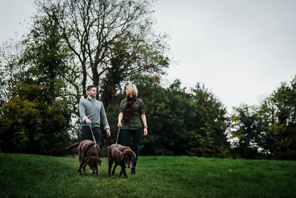 Couple taking dogs for a walk at Grantchester Meadows