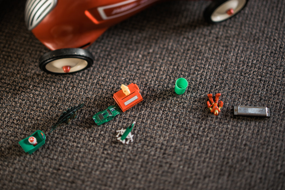 Copy of red and green children toys laid out on floor