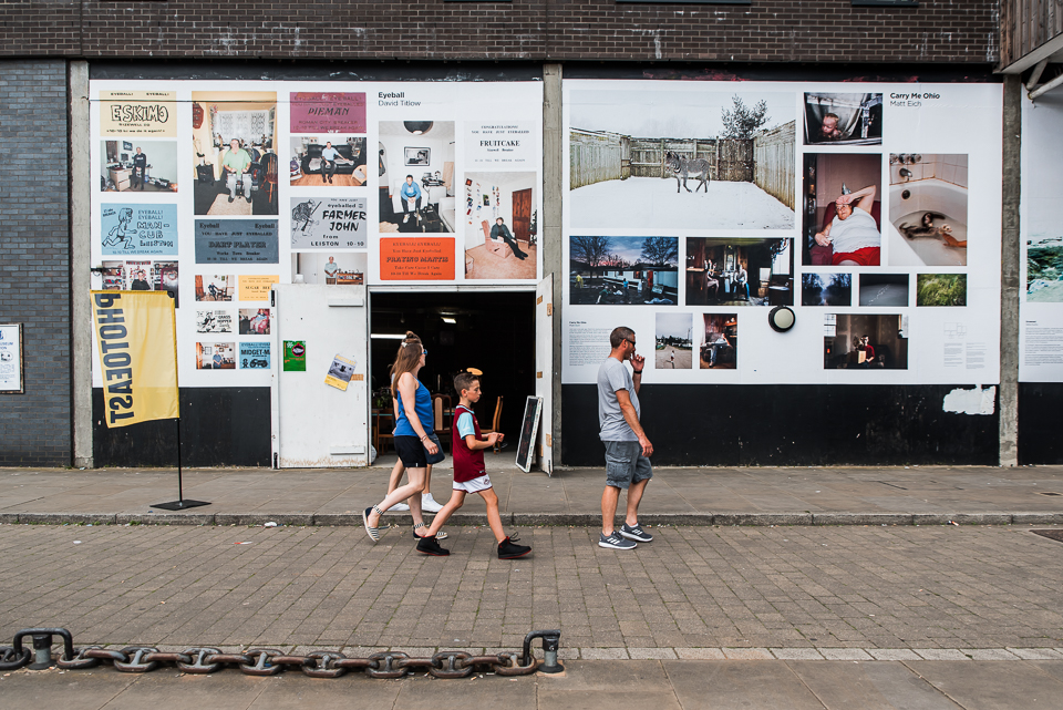 Photography hoardings on the waterfront outside the community ca
