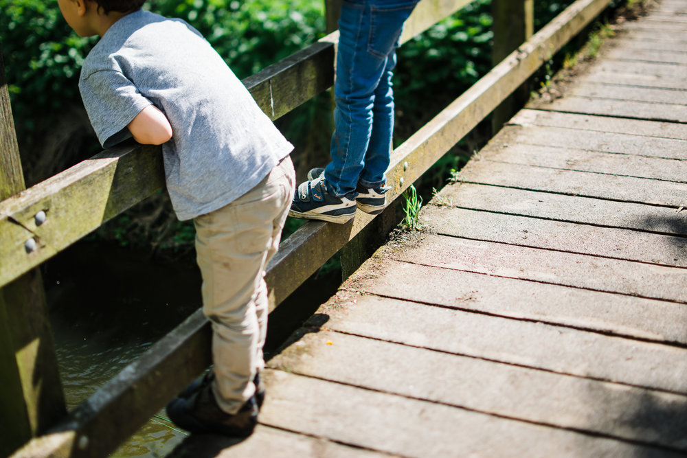 Two children standing on the bridge colour photograph