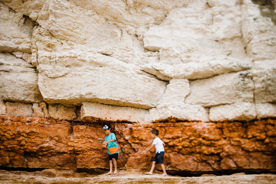 Children playing on the sandstone cliffs at Old Hunstanton