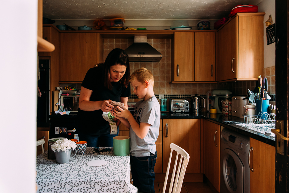 Mother and her young son in the kitchen