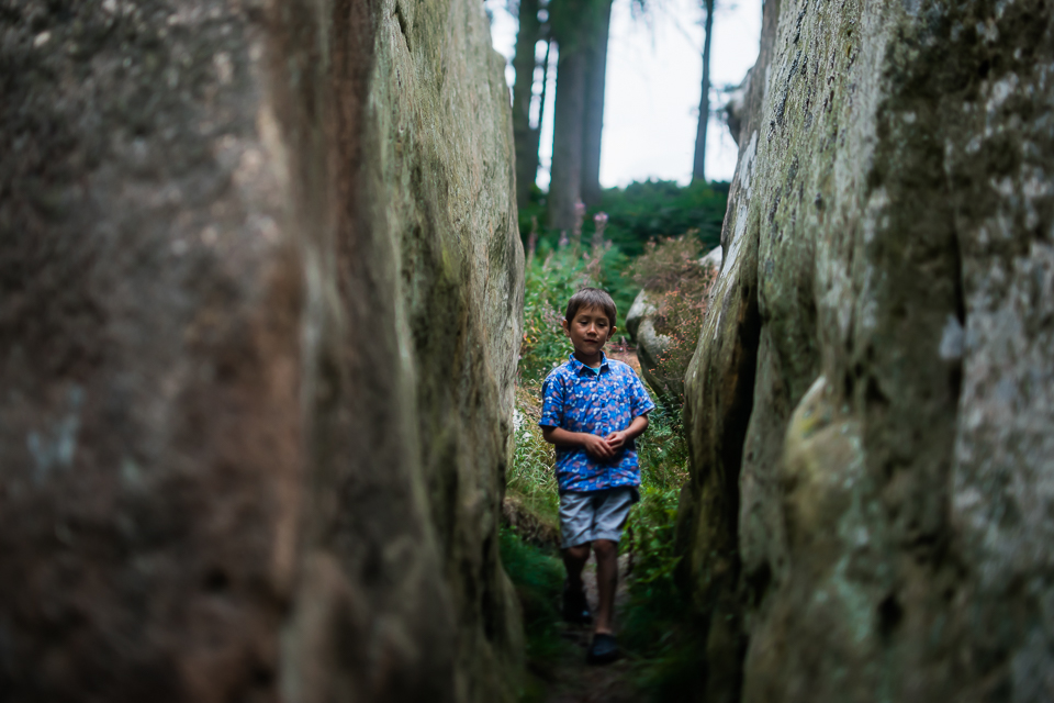 Boy standing between two rocks