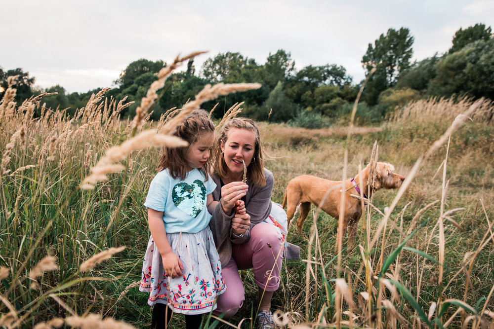 Mother and daughter amongst the tall grass at Hinchingbrooke Cou