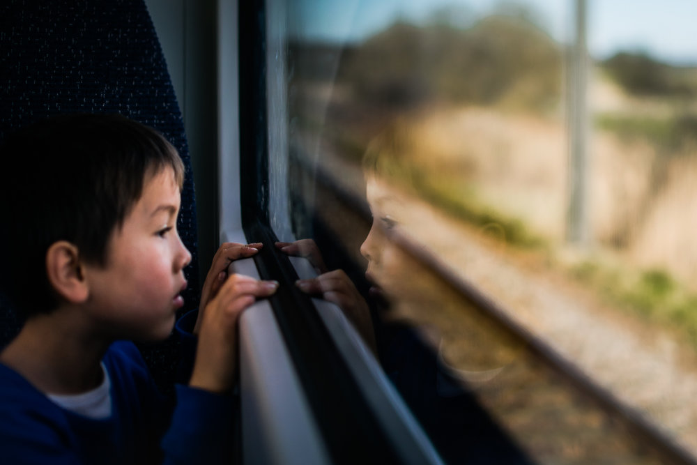 Freelensed photograph of boy on a train
